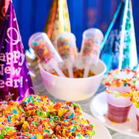 A Pop the Confetti party is perfect for New Year's Eve for kids! Simple DIY craft ideas, easy desserts, and yummy confetti looking food! I'm definitely doing this with with my toddler this year.