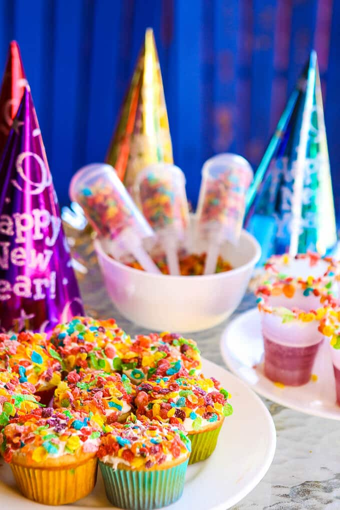 A Pop the Confetti party is perfect for New Year's Eve for kids! Simple DIY craft ideas, easy desserts, and yummy confetti looking food! Such fun New Year's Eve party ideas! I'm definitely doing this with with my toddler this year.