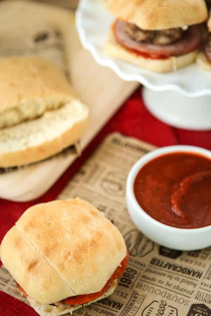 These meat lovers pizza sliders are the perfect Super Bowl food if you want to serve delicious appetizers. Three meats combined inside one amazing slider roll makes the perfect addition to your Super Bowl party, and one of the easiest Super Bowl recipes you can make! I'm definitely making these for my Super Bowl party this year!