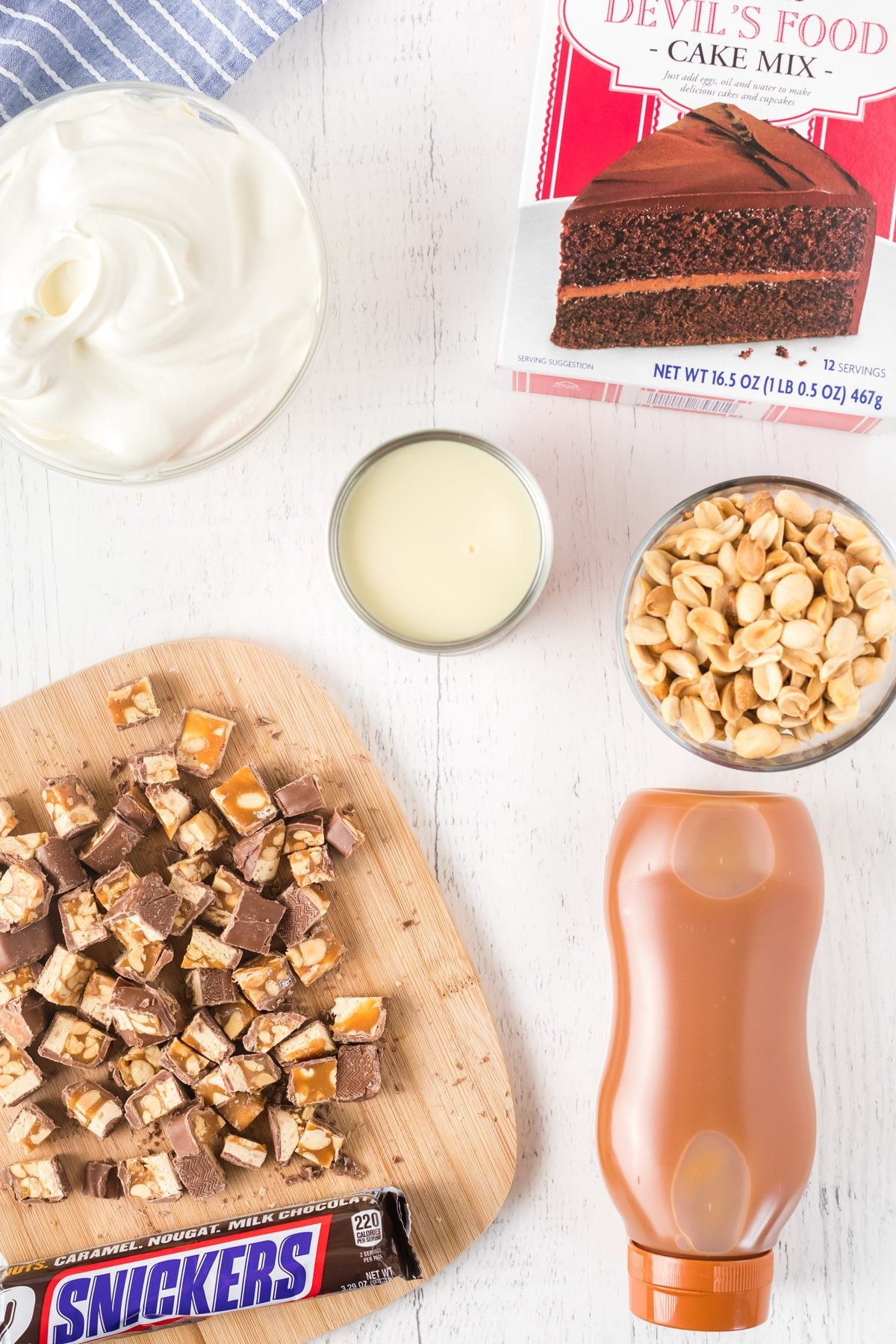 Ingredients for Snickers poke cake