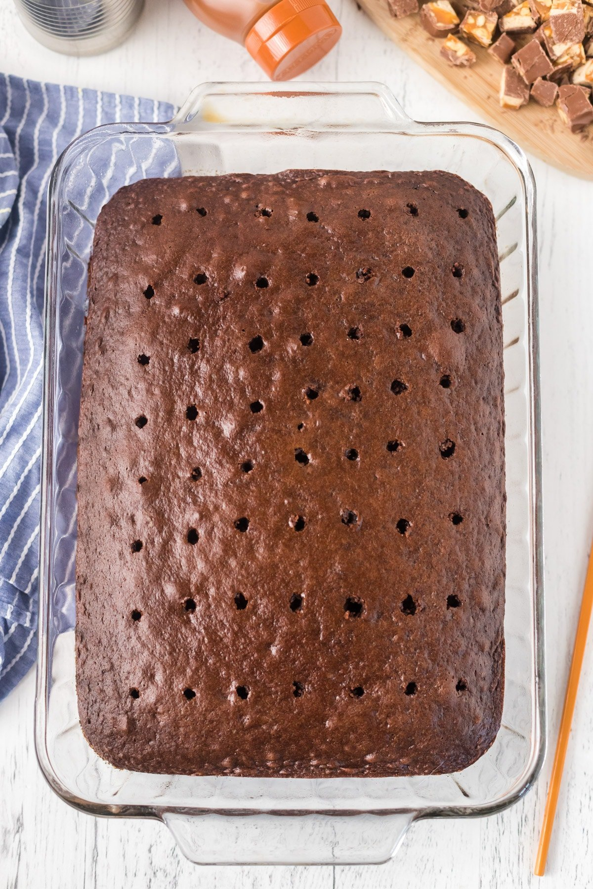 Chocolate cake with holes poked in it