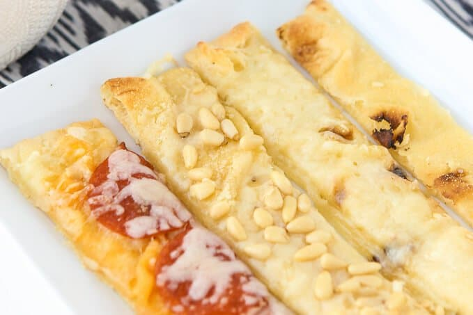 Simple breadsticks made in four different ways all from the same flatbread base! Such easy appetizers idea when paired with a delicious tomato sauce!