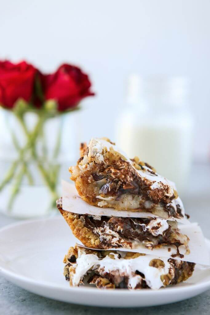 "These delicious 7 layer bars are inspired by The Bachelor and full of everything that makes The Bachelor so great - blondies, tropical flavors, chocolate, some non-alcoholic ""scotch,"" and nuts! One of those easy desserts where you just put everything together, bake, and it tastes amazing!"