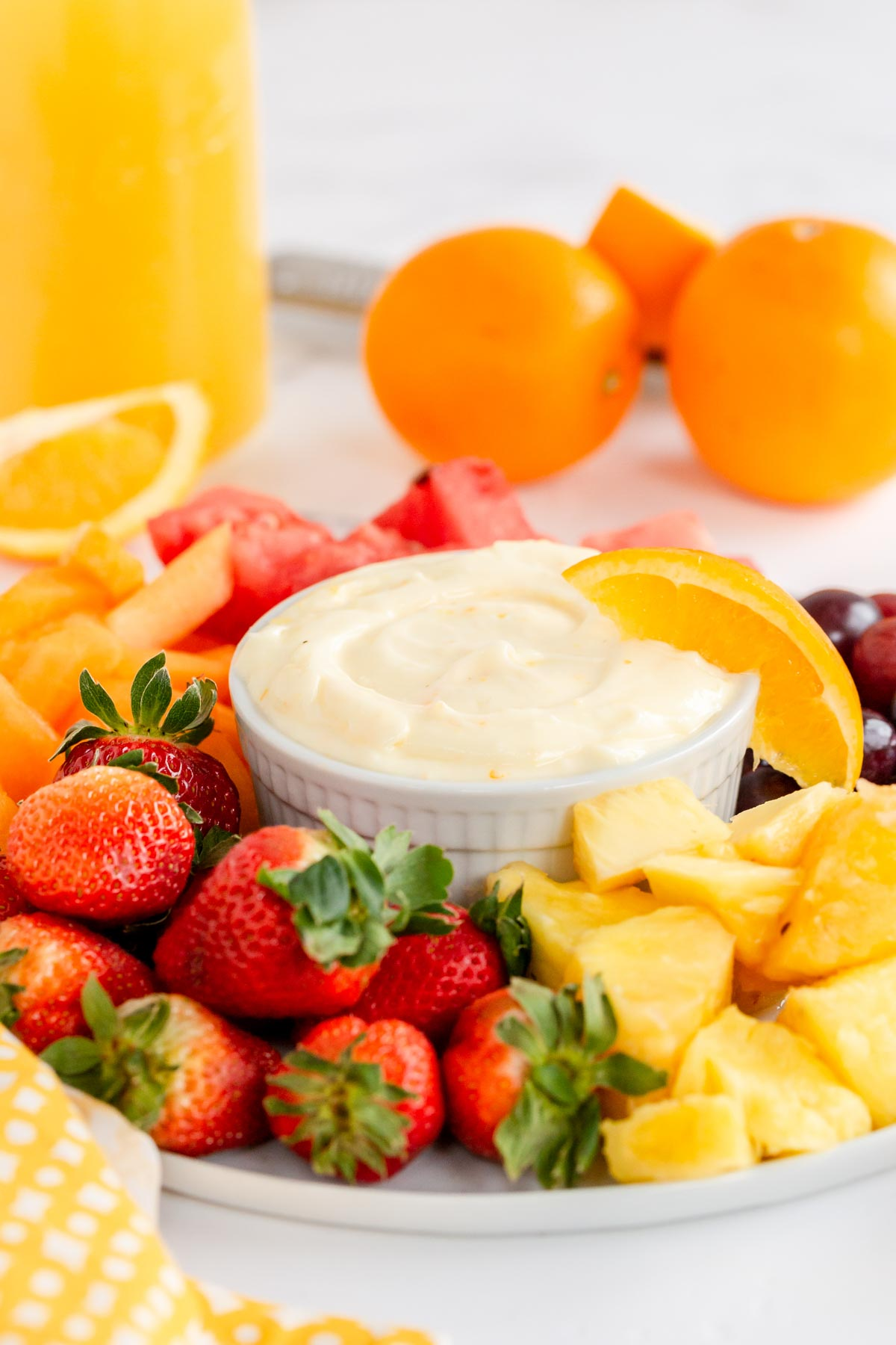 fruit tray with a bowl of fruit dip