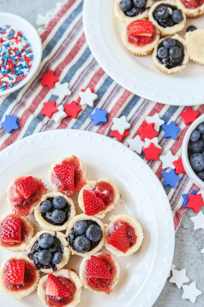 This red, white, and blue mini cheesecake recipe is the perfect 4th of July dessert or Memorial Day treat, a protein packed crust topped with a sweet cream cheese topping.