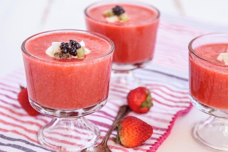 This strawberry soup tastes almost like a melted smoothie except better. Such a simple and easy recipe that uses fresh strawberries to create a healthy dessert option. Definitely one of the most unique strawberry ideas and perfect for summer entertaining!