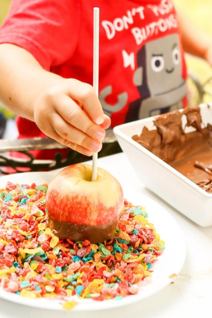 These DIY rainbow chocolate covered apples are the perfect kid friendly DIY dessert. Great tips and a video showing you how to make chocolate apples and ideas for using both white and milk chocolate to make gourmet colored apples. You'll never need to use a recipe again!
