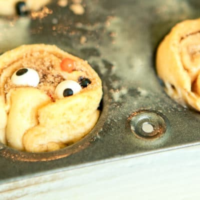 These monster inspired mini cinnamon rolls are the perfect monster food for Halloween! Start with Pillsbury crescents and turn them into something that both kids and adults will love. They're great for a party, for Halloween breakfast, or when you want something homemade but don't have time to make cinnamon rolls from scratch. I love the fun little surprises inside.
