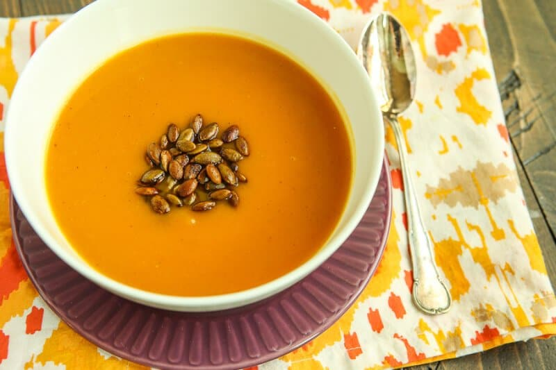 This easy butternut squash soup is like a healthy comfort food! Take some roasted butternut squash, mix it with broth in your Vitamix or other blender, and finish it off with some spicy pepitas. It's creamy, dairy free, and one of the best butternut squash recipes I've tried!