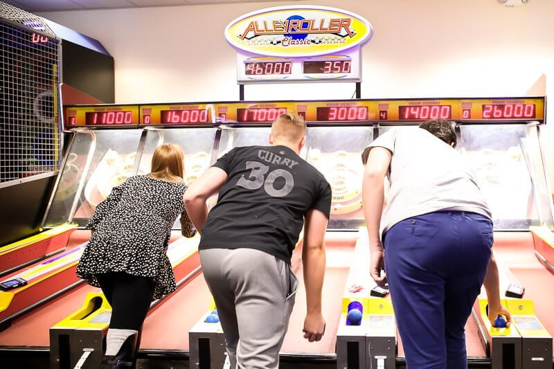 Playing skeeball at a Chuck E Cheese birthday party