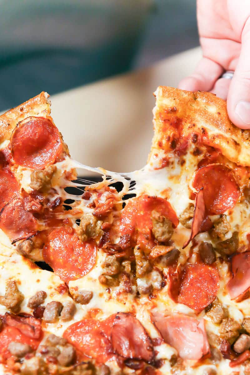 Pizza is one of the menu options included at a Chuck E Cheese birthday party
