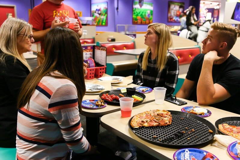 Enjoying food from the Chuck E Cheese menu at a Chuck E Cheese birthday