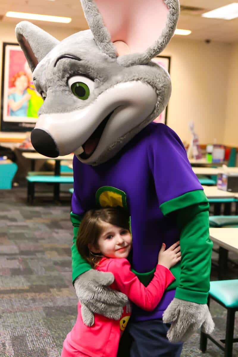 Hugging Chuck E Cheese at a Chuck E Cheese party