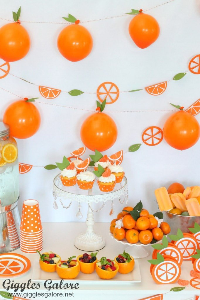 Orange birthday party decorations made with the Cricut Explore Air