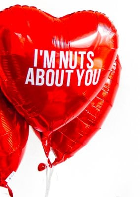 For traditional candy grams! This year for Valentine's Day, kick old-school candy grams up a notch with this fun DIY balloon candy gram idea! With tons of clever candy bar sayings and simple instructions, this makes the best gift for boyfriend or any valentine! Love the list of other Valentine's Day gifts for him at the bottom too!