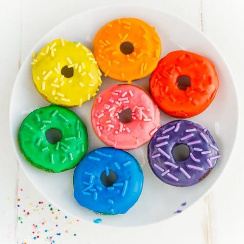 This rainbow donuts recipe is perfect for a rainbow party, St. Patrick's Day party food, or anytime you just need a little color in your life! Definitely one of the best rainbow foods and there's a secret ingredient that'll make you feel even better about eating them, way better than if you eat rainbow cake!