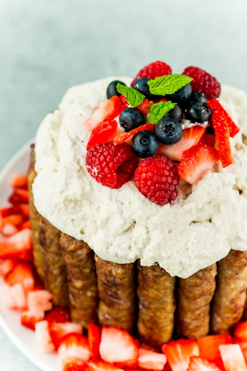 This sausage and pancakes breakfast cake with maple whipped cream needs to be on everybody's list of Easter brunch recipes It's impressive yet simple enough that anyone can make it, and it's an Easter brunch food that everyone will be talking about for the next year! All of your favorite Easter breakfast foods combined in one delicious breakfast cake recipe! Kids and adults both will love it!