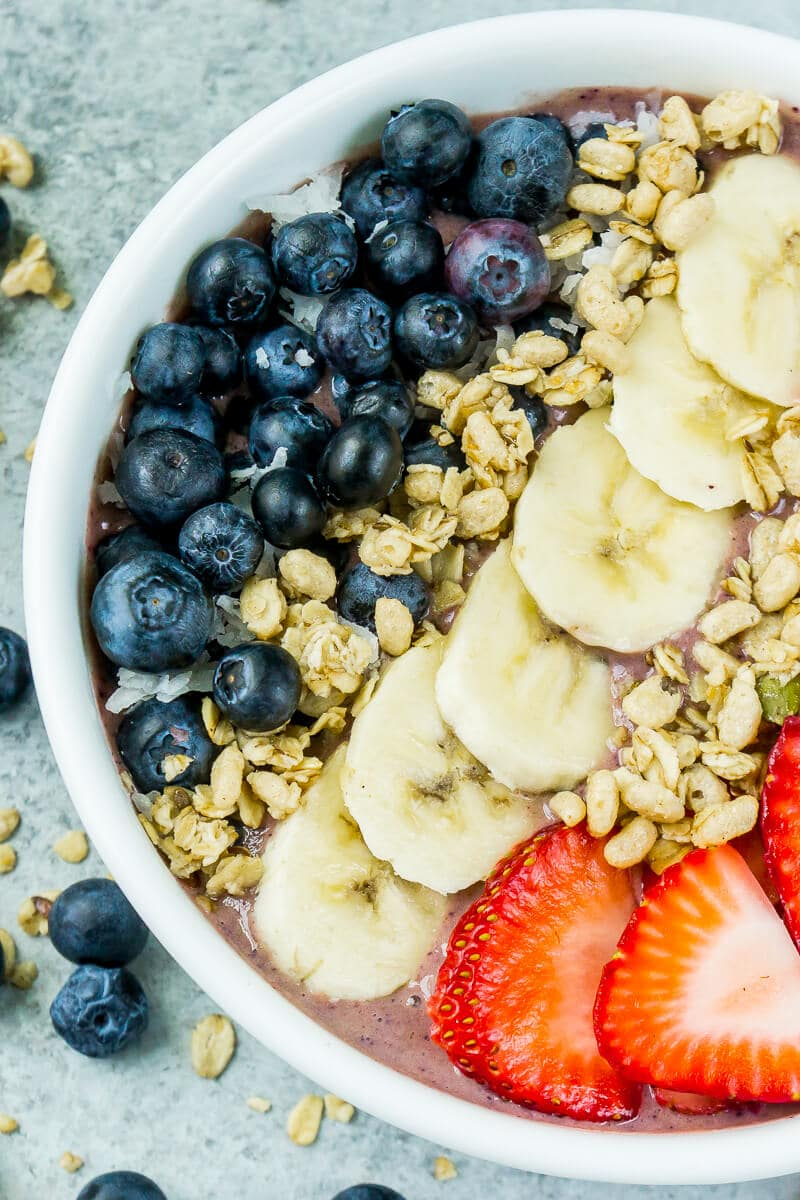 This red white and blue very berry smoothie bowl recipe is not only an easy and healthy breakfast option but also delicious! Add frozen strawberry, a little veggie protein powder, and your favorite berry for one great recipe!