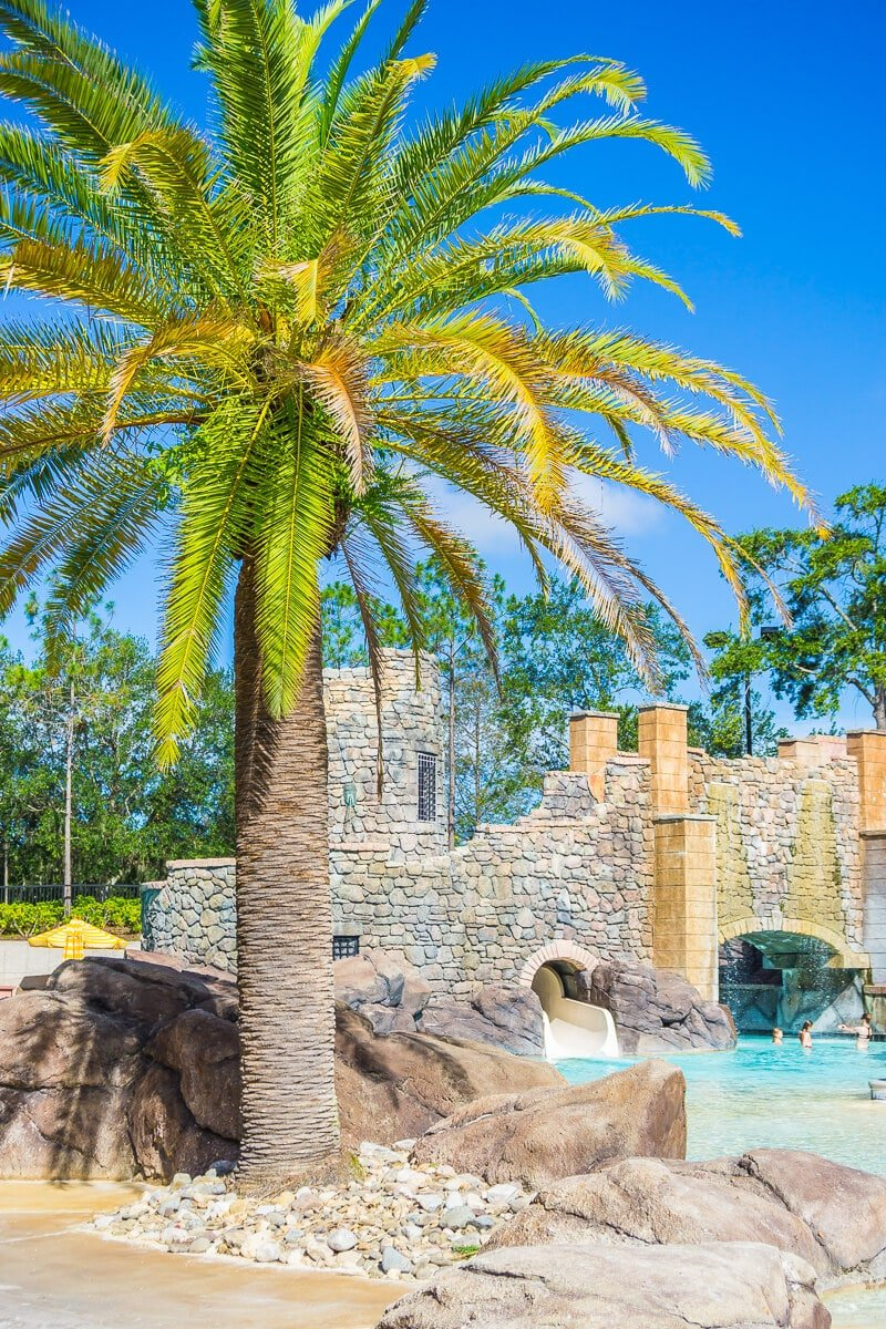 Beautiful palm trees line the pools at Loews Portofino Bay Hotel