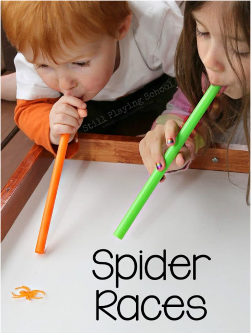 Kids doing spider races and other Halloween party games