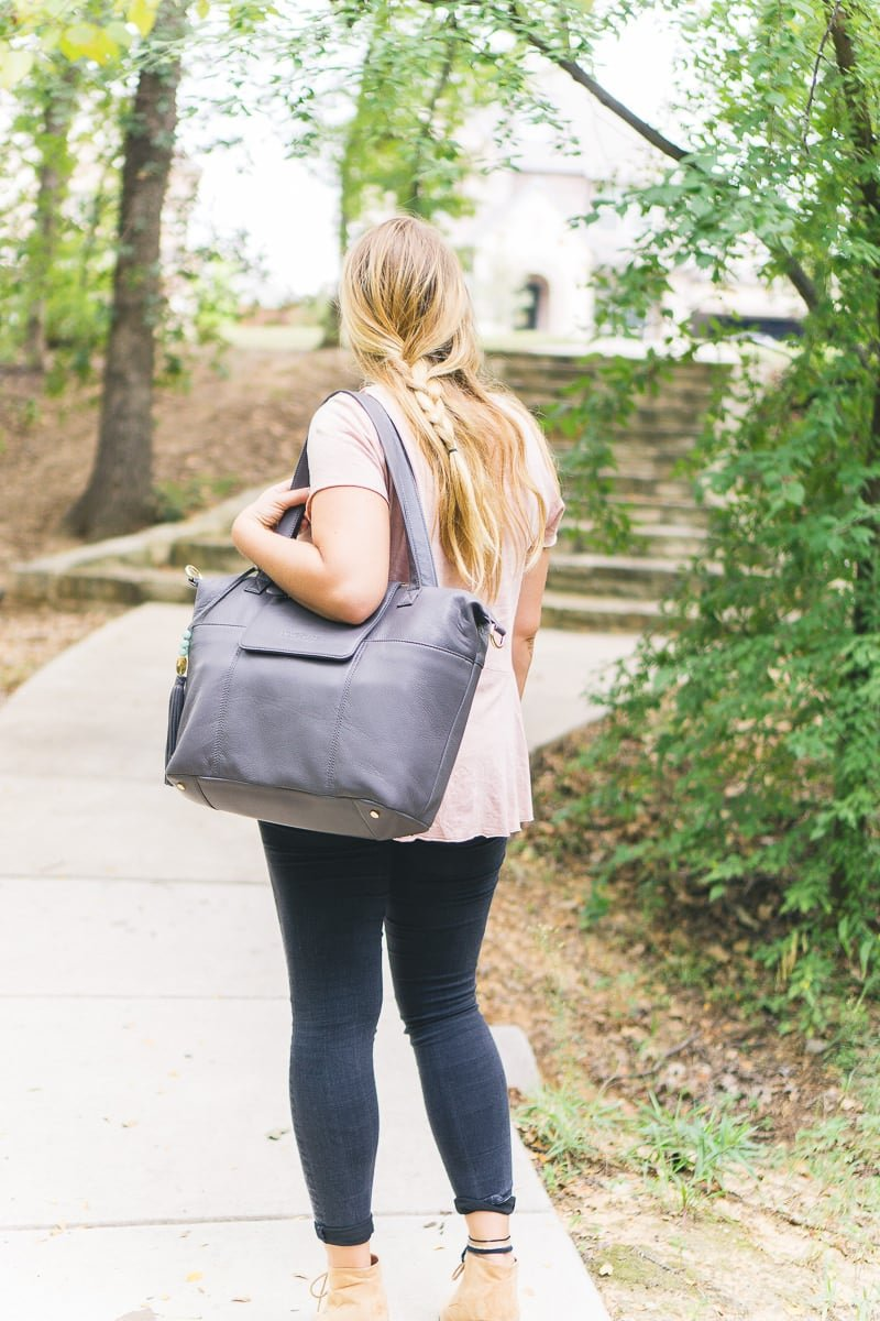 The Lily Jade diaper bag can be worn backpack or messenger bag style.