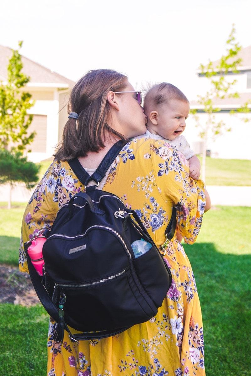 Lily Jade diaper bag backpack on mom's back