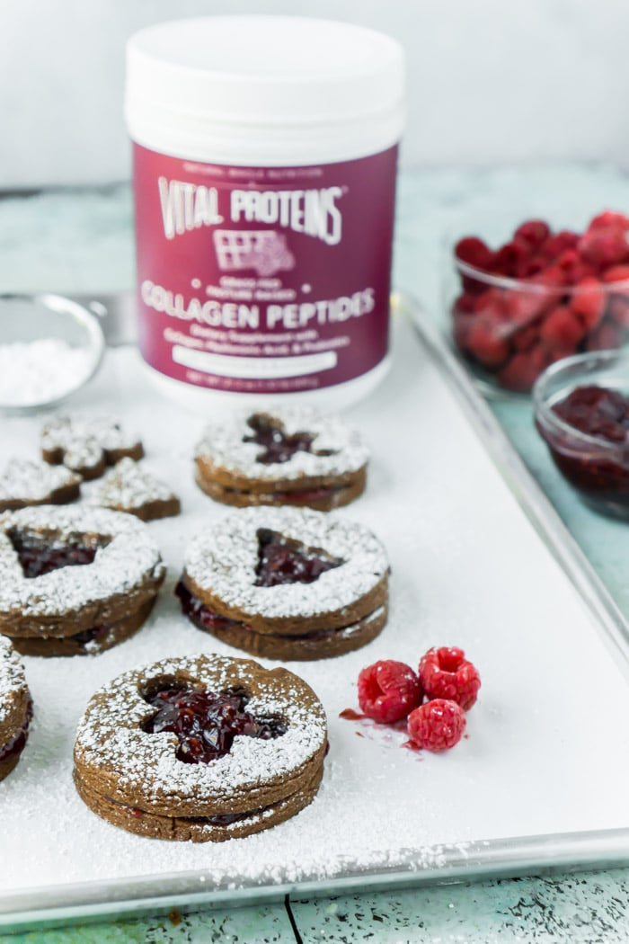 LIghtly sprinkle linzer cookies with powdered sugar