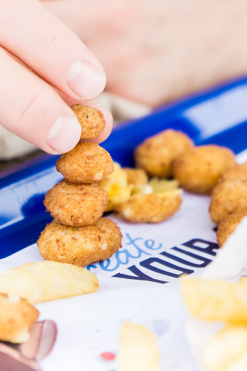 Stack cheese curds on top of each other in this fun photo scavenger hunt