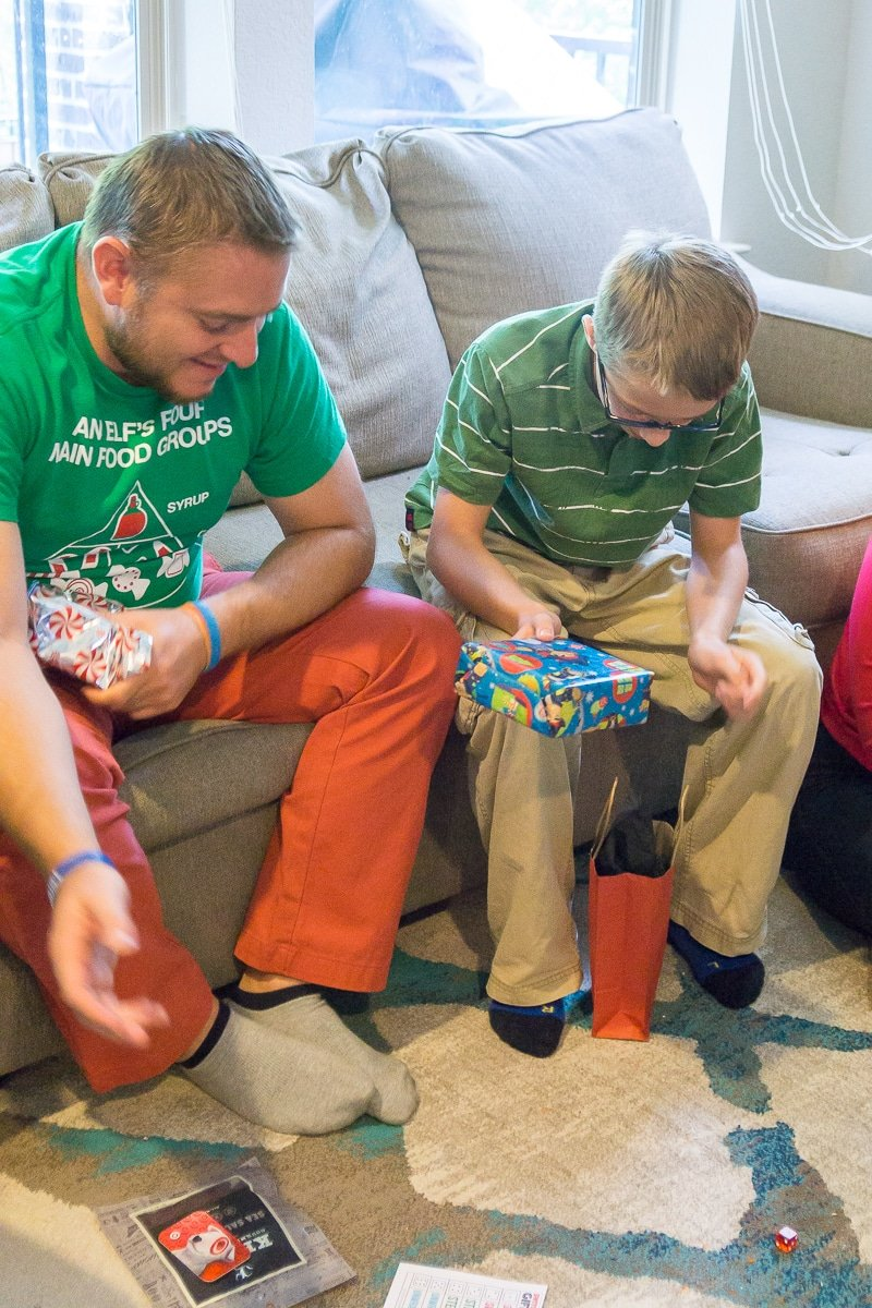 A family playing the switch steal unwrap gift exchange game
