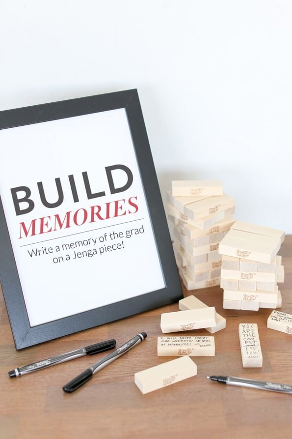 Jenga game with a build picture frame and pens