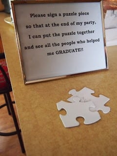 Puzzle pieces with a graduation sign