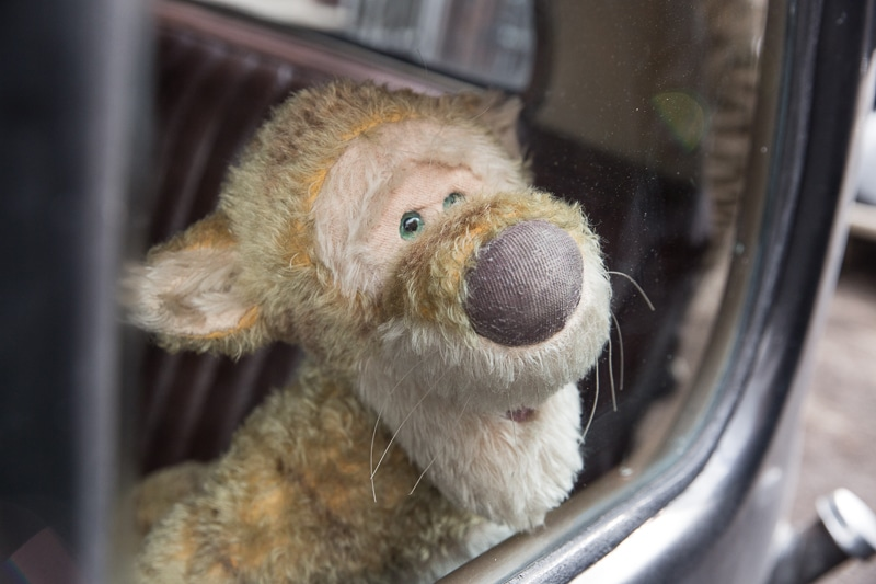 Tigger sitting in a car in Disney's Christopher Robin movie