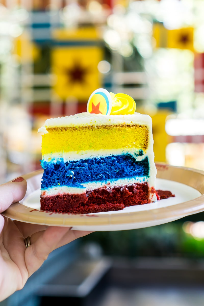 The Pixar layered cake is one of the best Pixar Fest food menu items