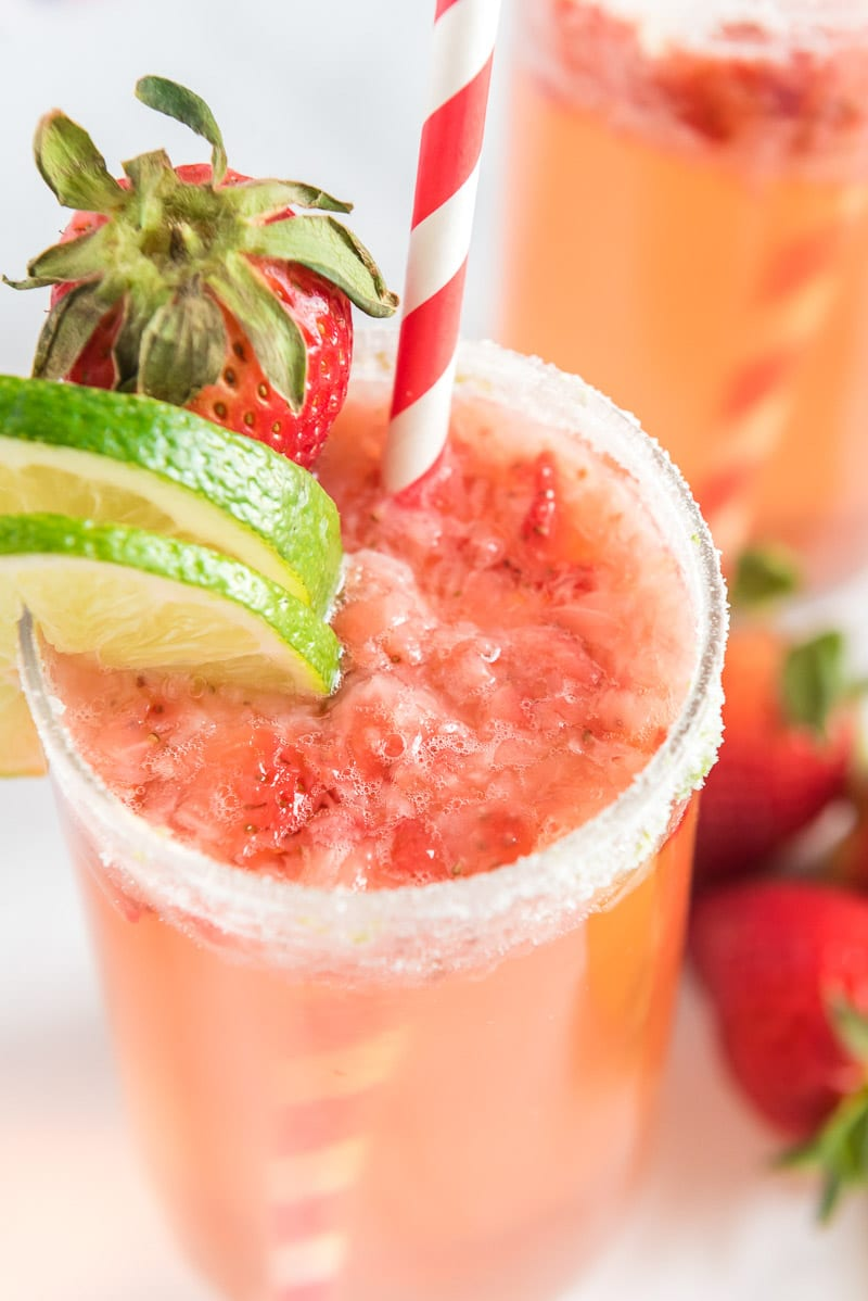 Strawberry mocktail garnished with strawberry citrus fruits