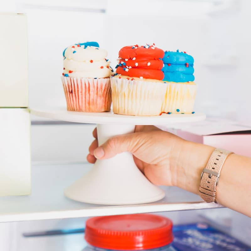 Red white and blue cupcakes being put into the Gladiator All Refrigerator