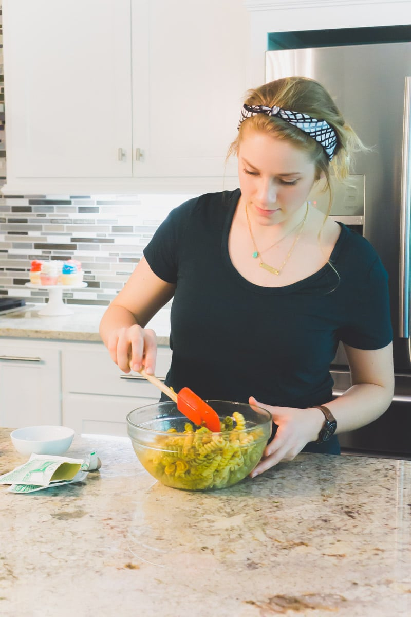 Adding sauce to pasta salad for a 4th of July party