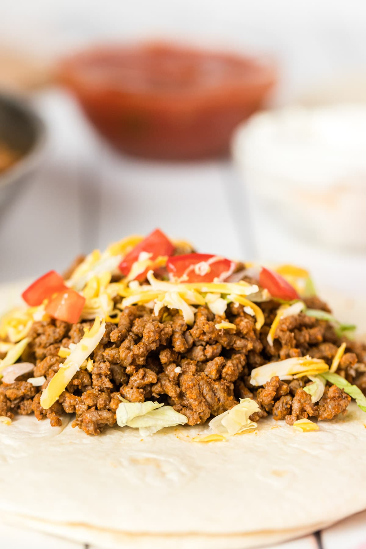 Homemade taco meat on a tortilla
