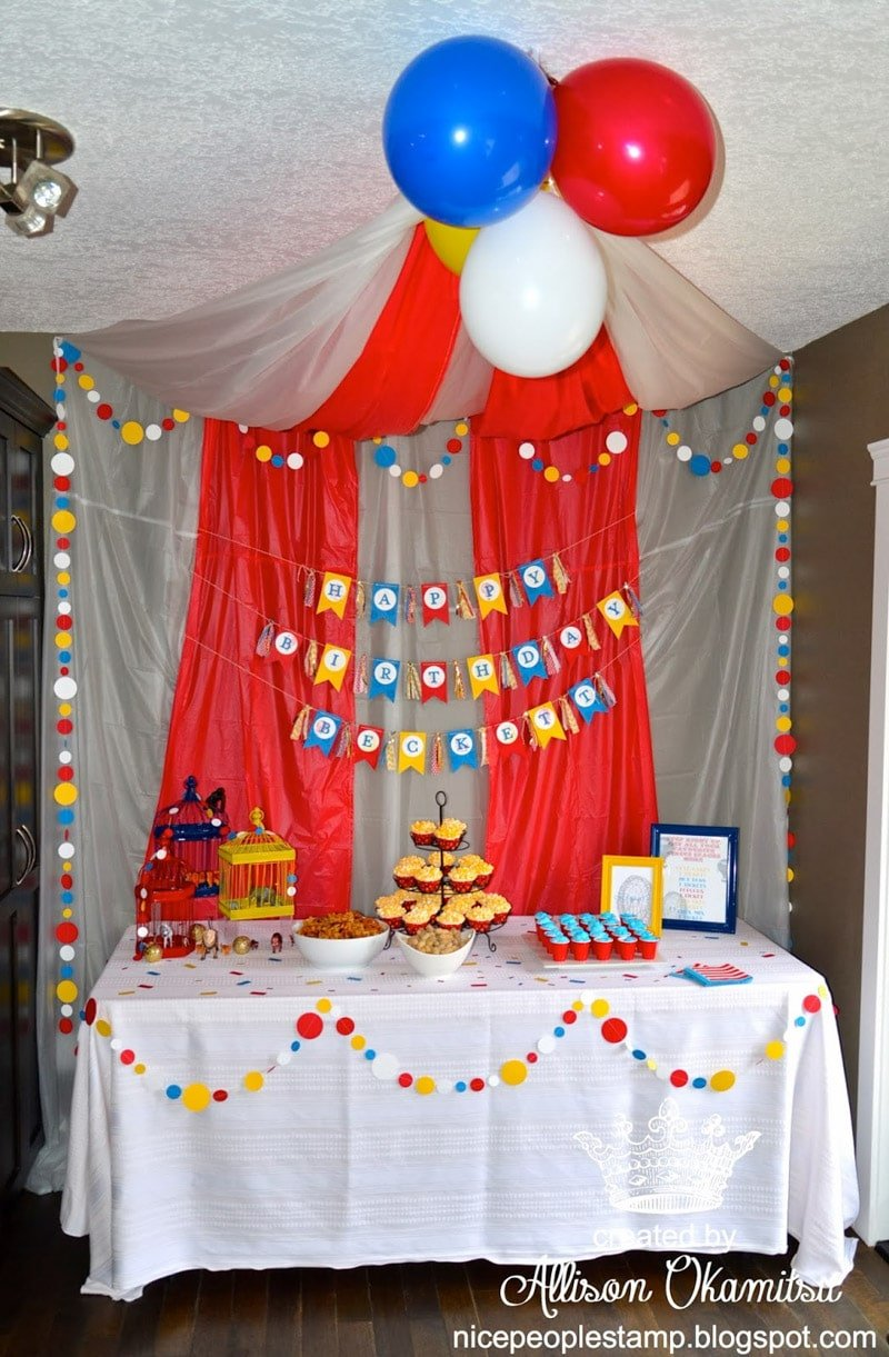 Circus party table with a DIY tablecloth tent