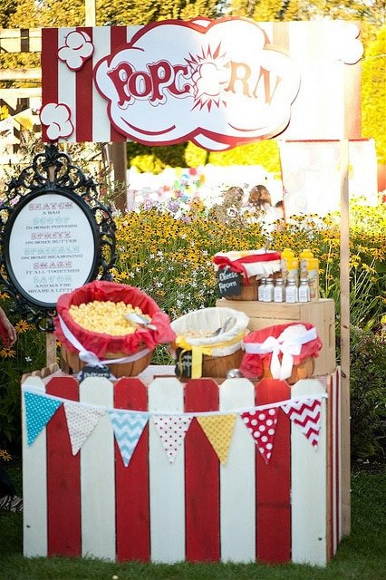 A popcorn bar doubles as circus party decorations and food