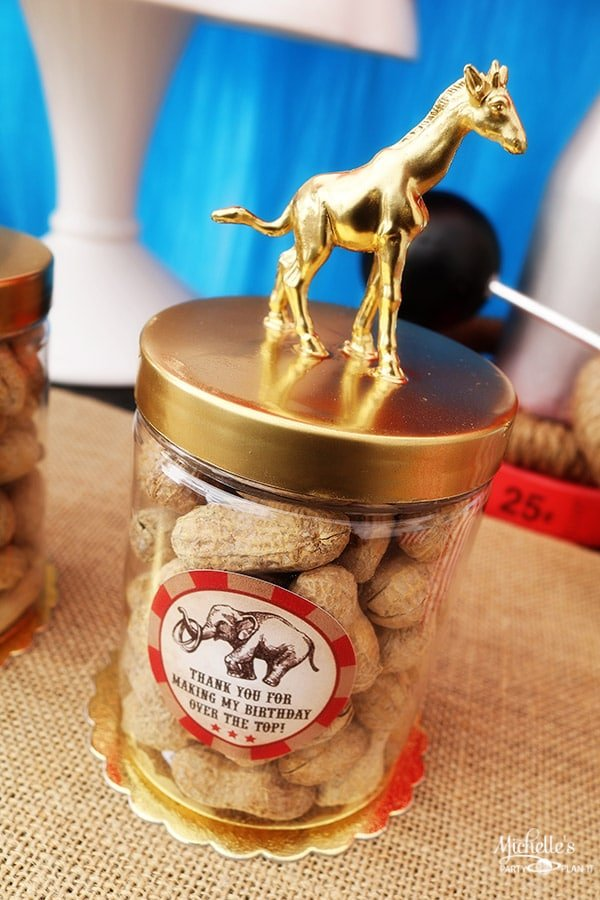 Gold animal topped circus party favors