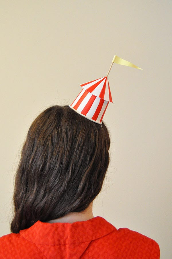Circus party hat on top of a girl's head