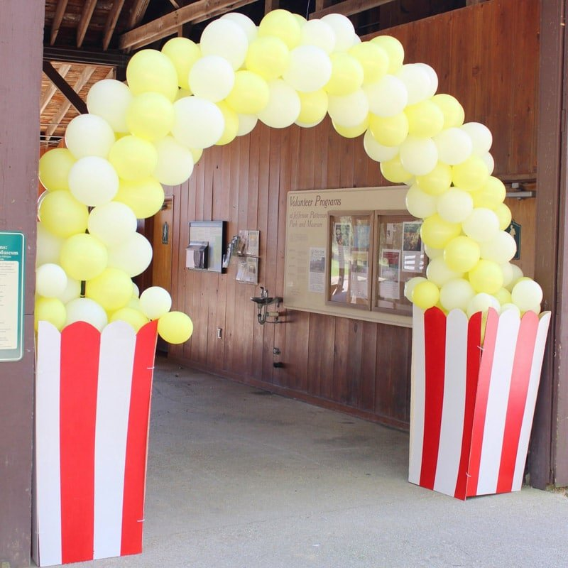 A popcorn arch at a circus theme party