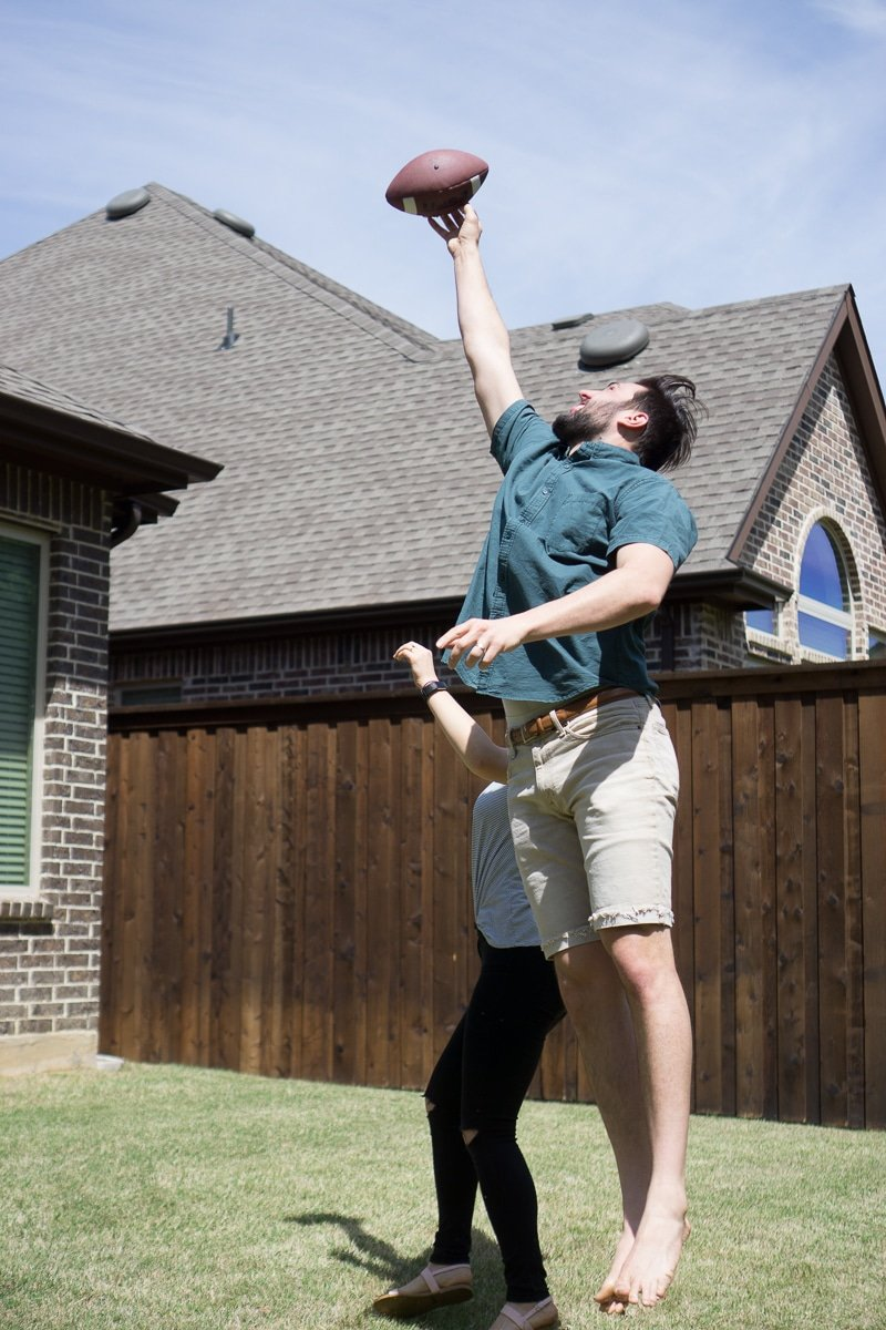 Jumping for a football in 500, one of the best outdoor games for adults