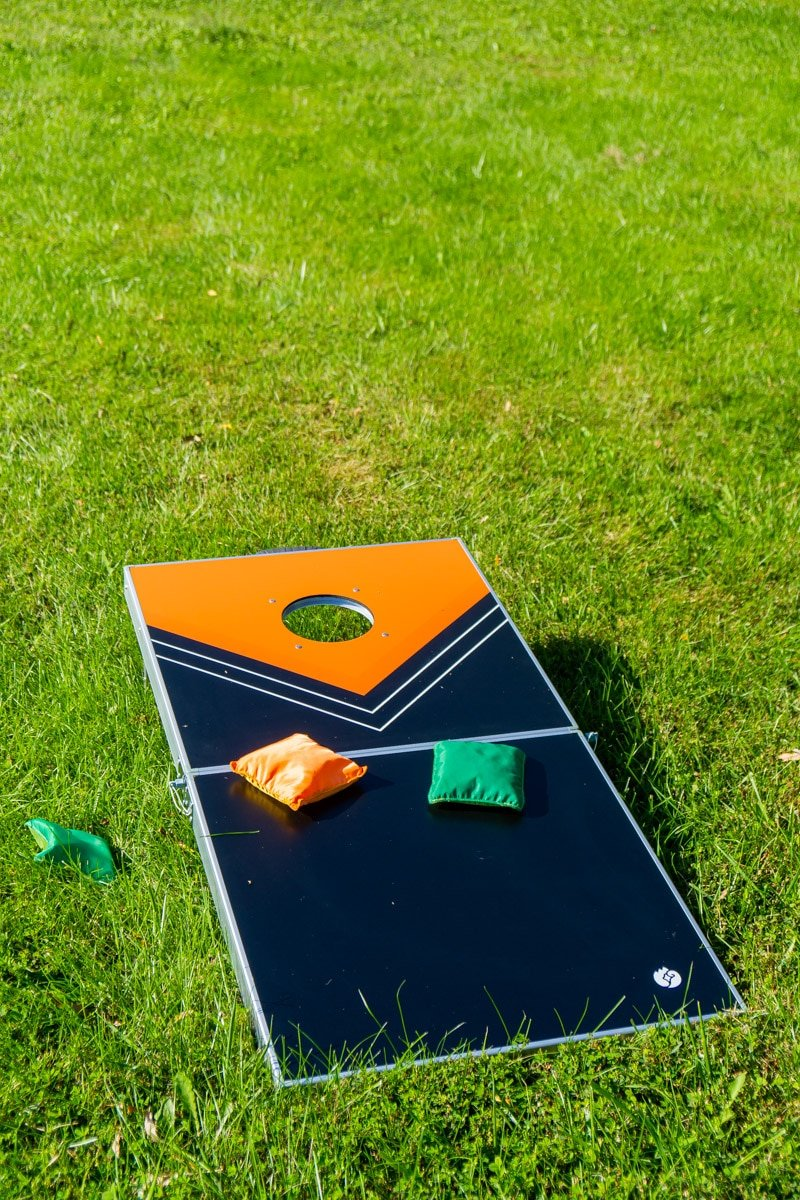 Corn hole board and other outdoor games