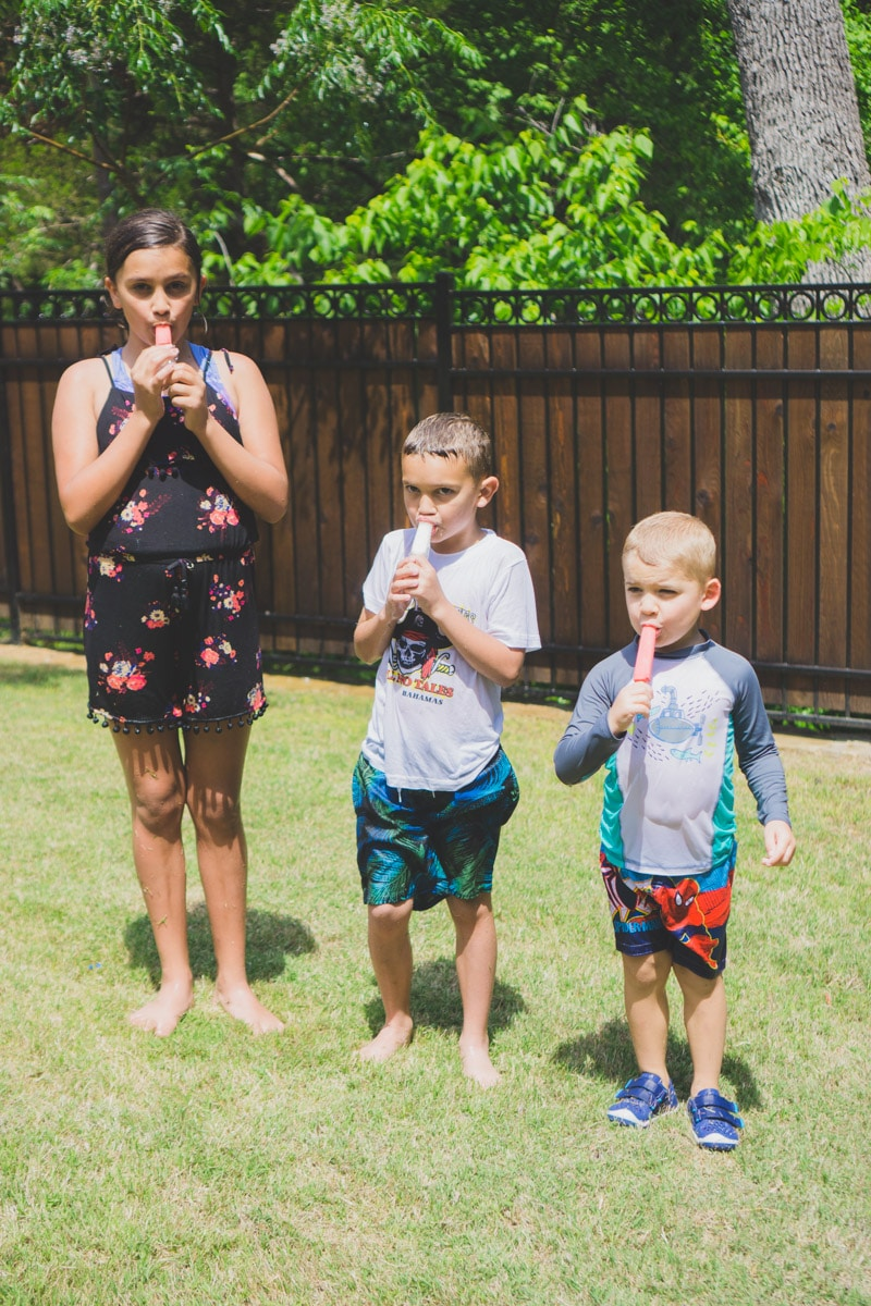 Eating red white and blue popsicles at a 4th of July party