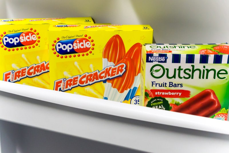 Red white and blue popsicles in a freezer door
