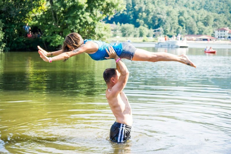 A woman being held in the Lake Lure DIrty Dancing lake lift competition