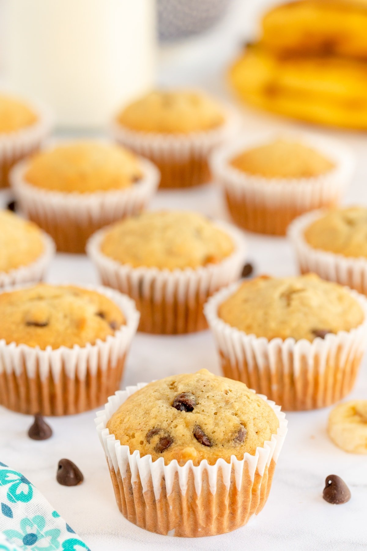 banana chocolate chip muffins in white cupcake wrappers