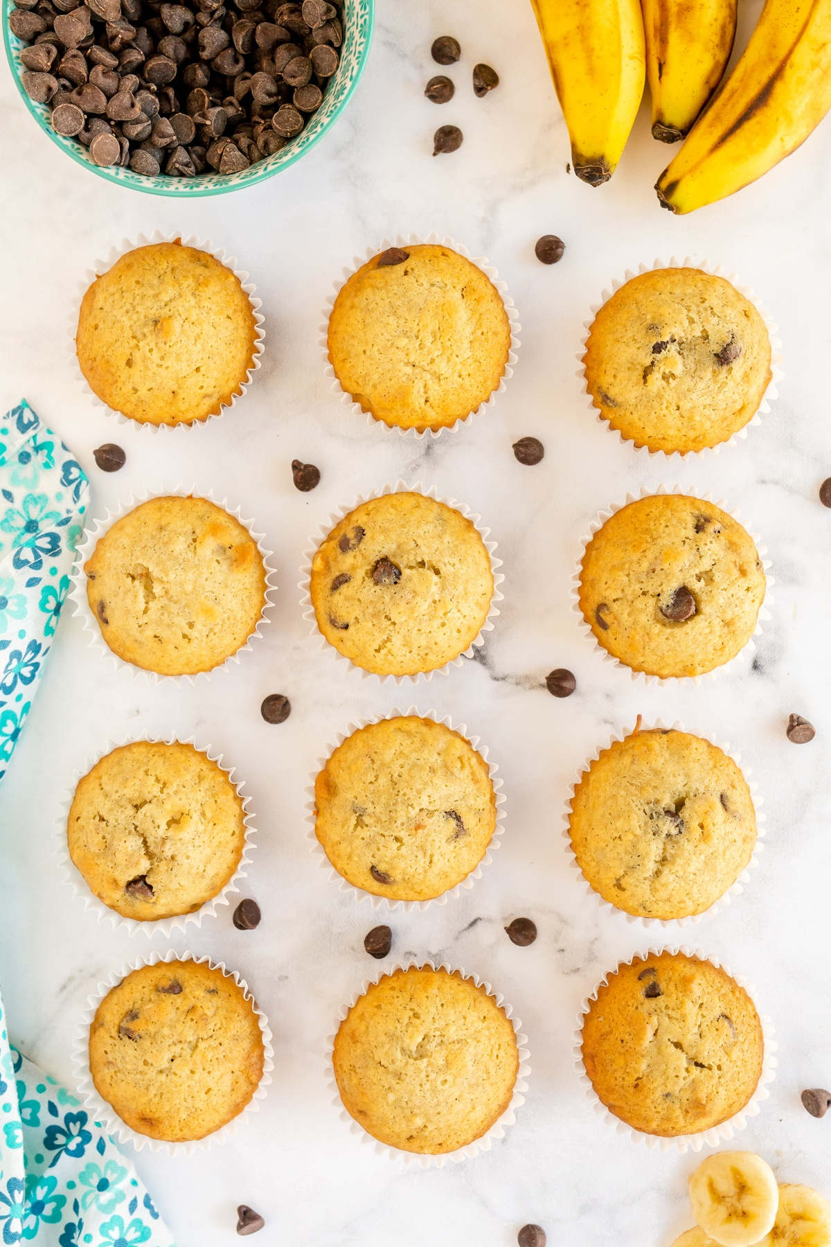 Banana chocolate chip muffins in a row
