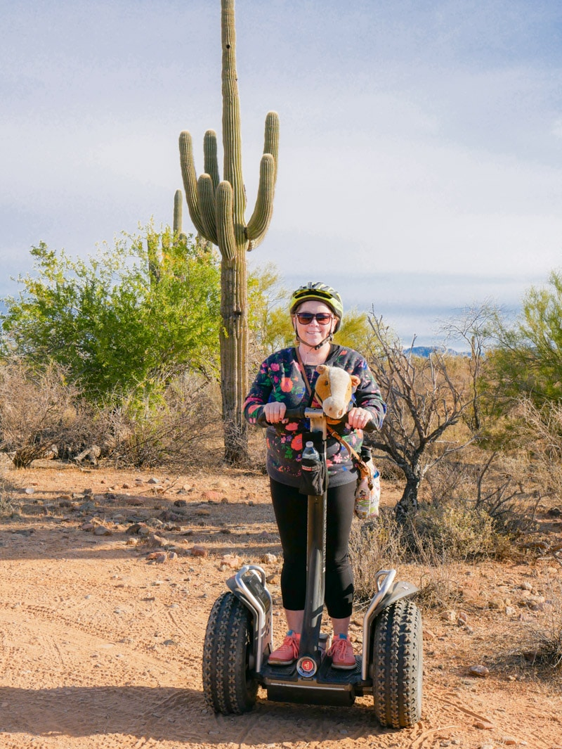 A girl riding a segway in the desert as part of the Fort McDowell Adventures tour
